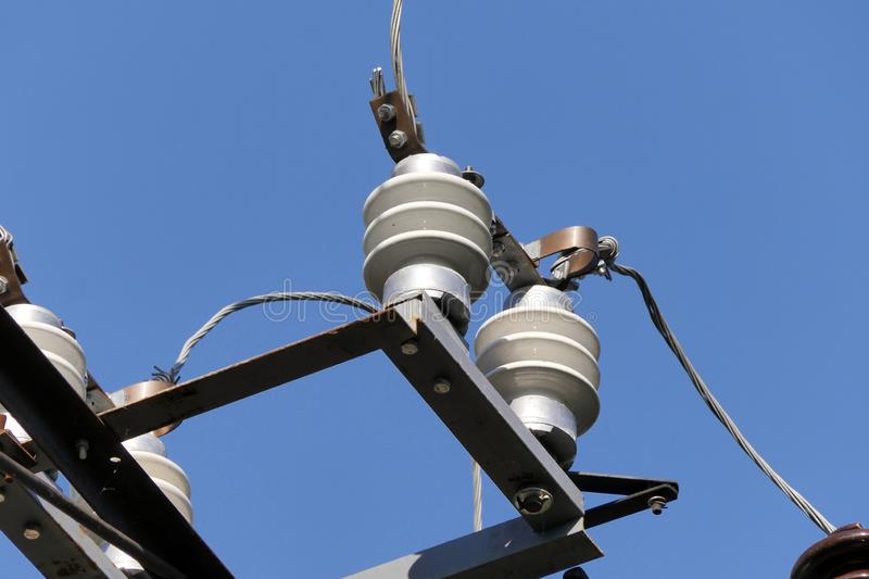 Clos up view of isolators with high voltage wires with blue sky royalty free stock image
