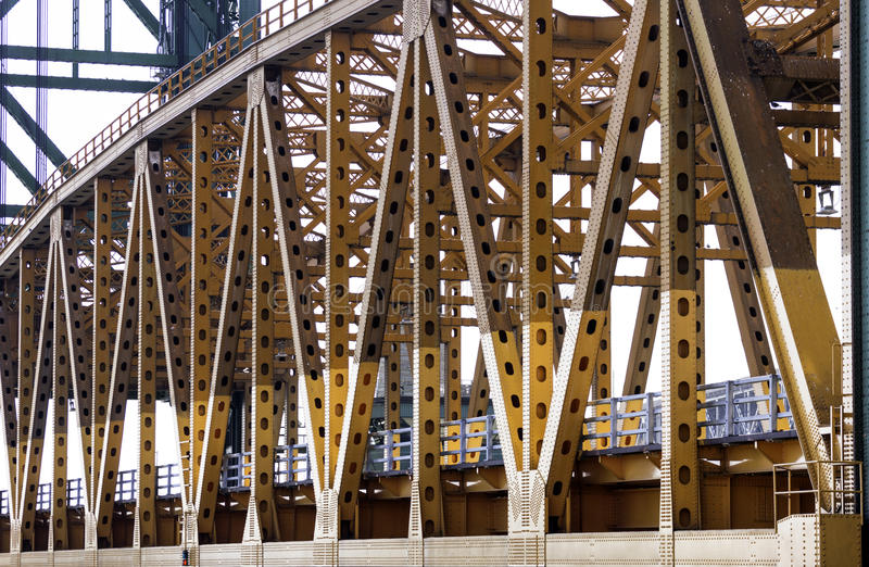 Close angled view of orange metal lift bridge, detail in beams a royalty free stock photography