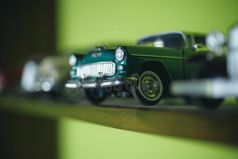 A close attention to the details. Retro styled cars. Toy cars with retro design. Retro car models on shelf. Classic. Model vehicles or toy vehicles. Miniature stock image