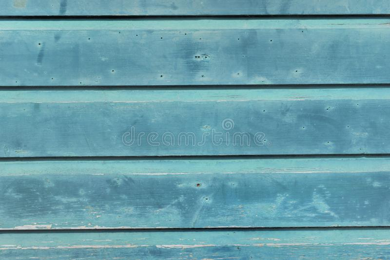 Blue wooden board of a cottage outdoor facade. Close on blue  wooden board of  a cottage outdoor facade stock photography