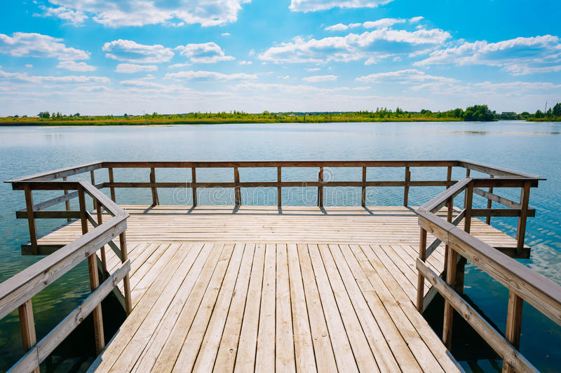 Close Boardwalk Viewing Platform Area Above Lake River Water Summer. Close View Of Wooden Boardwalk Batten Viewing Platform Area Above The Water Of Lake River In royalty free stock photo