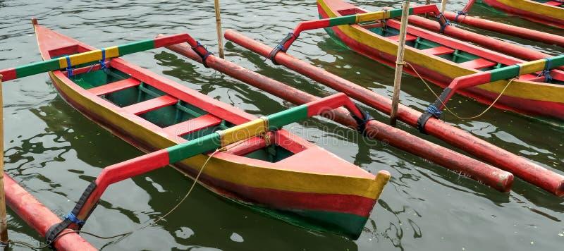 Close of boats at ulun danu beratan temple beside lake beratan on bali. Close of boats at ulun danu beratan temple beside lake beratan on the indonesian island royalty free stock photos