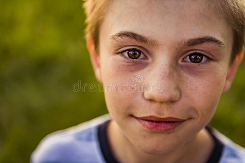 Close boy portrait at the sunset stock images