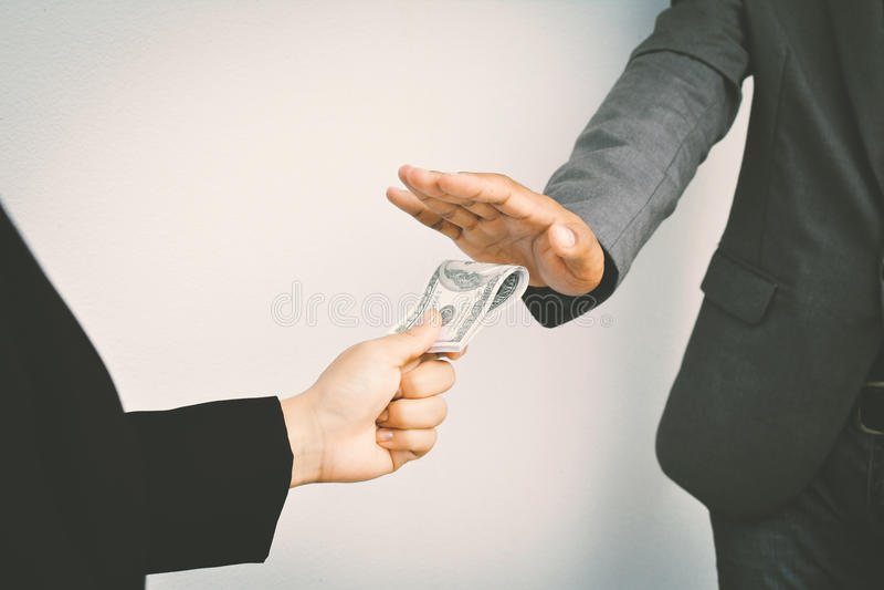 Close of businessman hands holding money stock photo