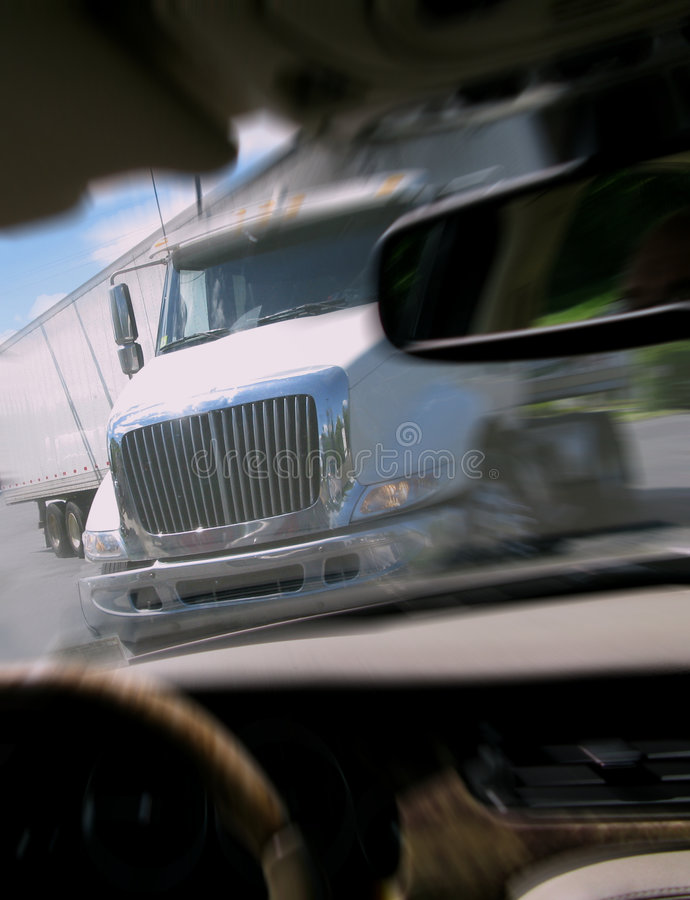 Close Call Car Crash with Tractor Trailer Truck. Close call crash avoidance with tractor trailer truck viewed from inside a car avoiding an imminent serious royalty free stock photos