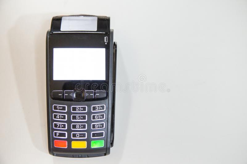 Close credit card swiping machine to pay. Credit card swipe through terminal for payment in cafeteria stock photo