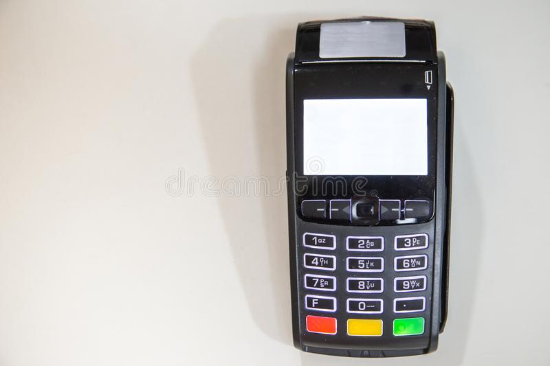 Close credit card swiping machine to pay. Credit card swipe through terminal for payment in cafeteria stock image