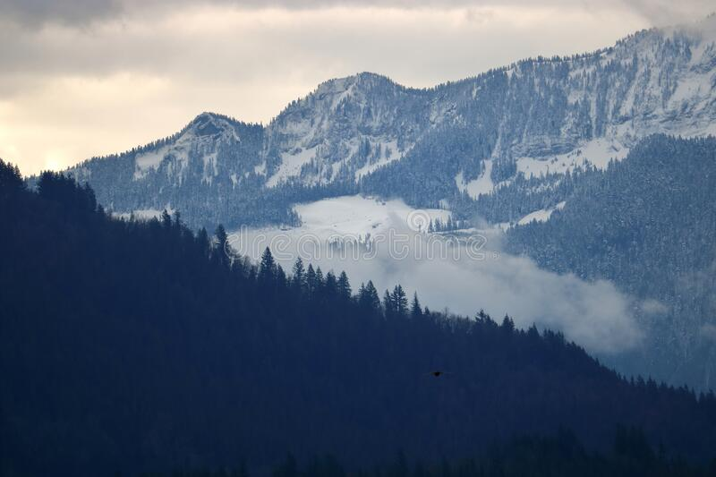 Washington State and Sumas Mountain Range. Close detailed view of a section of the Sumas mountain range and the steep elevations seen during the winter months stock photos