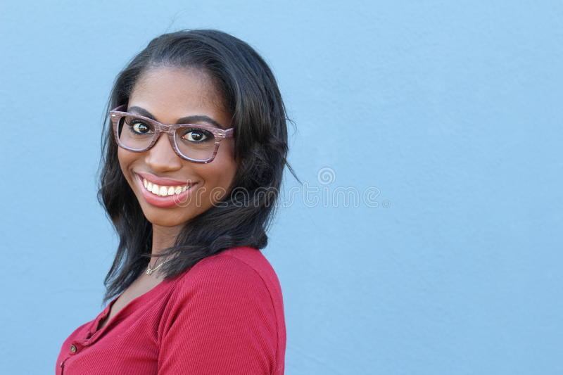 Close face of African female with glasses with copy space on the right royalty free stock images