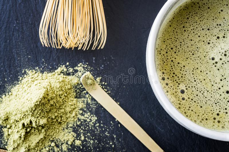 A close of freshly made matcha green tea and tools royalty free stock photography