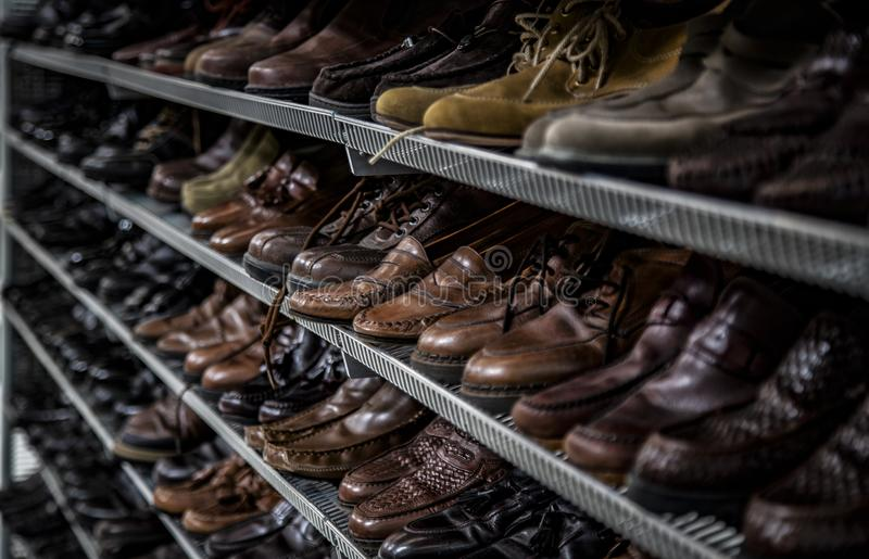 Men`s Neutral Colored Shoes Boots Thrift Store Shelves royalty free stock images