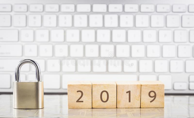 Close key lock with year number 2019, keyboard background stock images