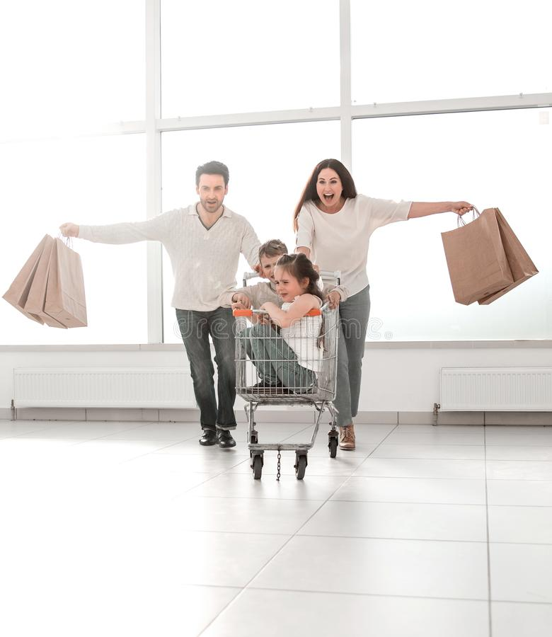 Close-knit family goes shopping. stock images