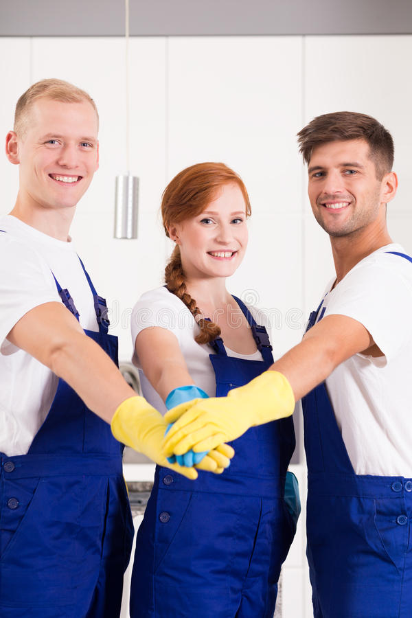 Close-knit team of cleaners stock photo