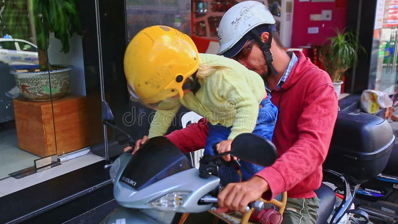 Close Little Blond Girl in Helmet Seats on Motorcycle by Shop