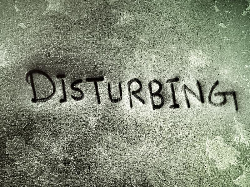 Close look of the English word disturbing written by pencil royalty free stock photos
