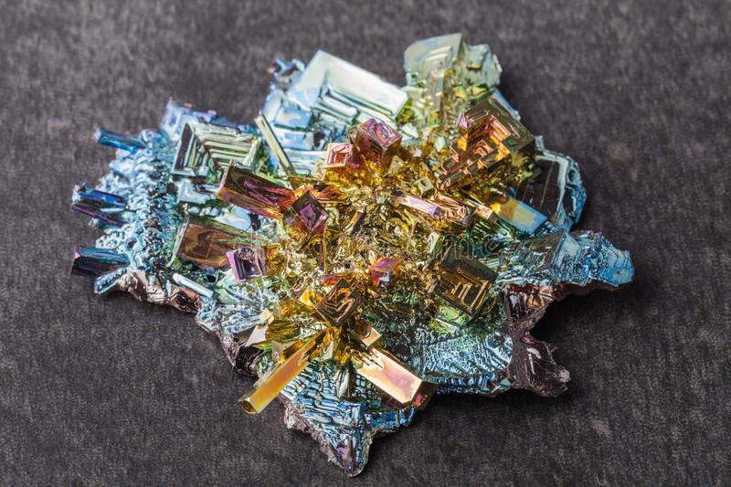 Close macro photograph of an artificially synthesized bismuth crystal royalty free stock image