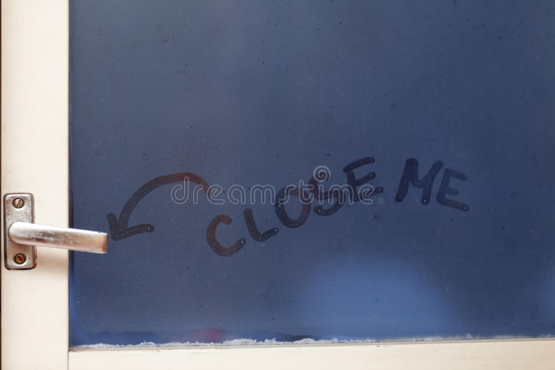 Close me reminder. Reminder on the window glass for keeping heat at home royalty free stock photography