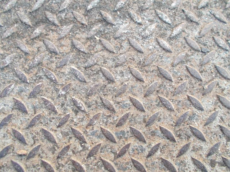 Close up old steel pattern with dirty of soil and sand on the path walk backgrounds stock images