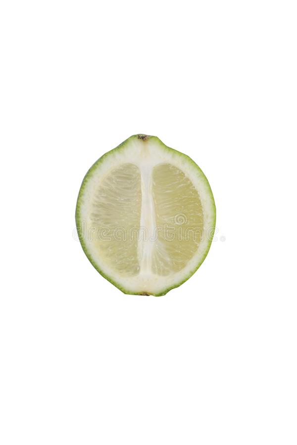 Close photo of isolated slice of lime. Close photo of isolated sliced along green lime on the white background royalty free stock images
