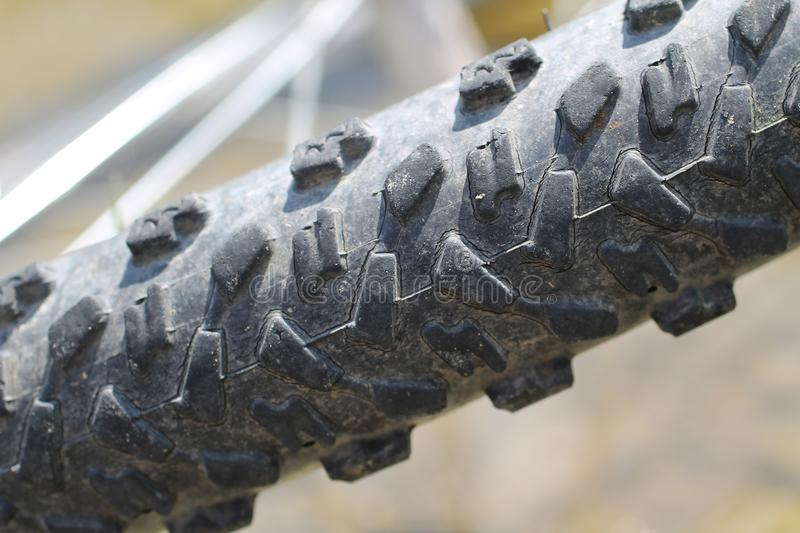 Bike tire. Close photo of a tire of mountain bike stock photography