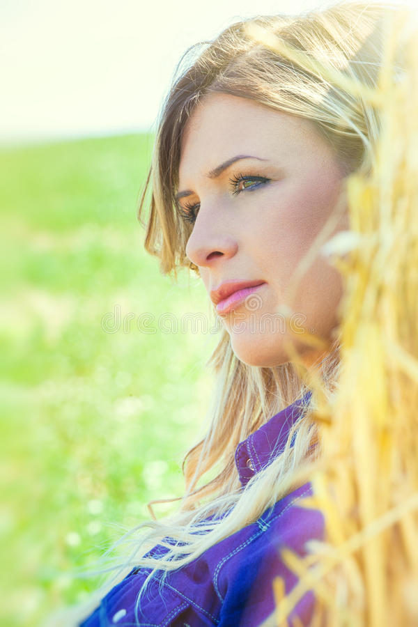 Close portrait of blonde young country woman stock photos