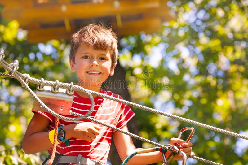 Close portrait of the boy at rope park near cable royalty free stock images