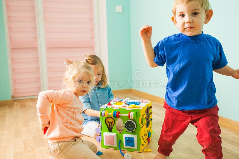 Portrait of boy and two girls playing together royalty free stock photography
