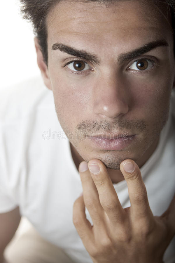 Close portrait handsone young man looking stock photo