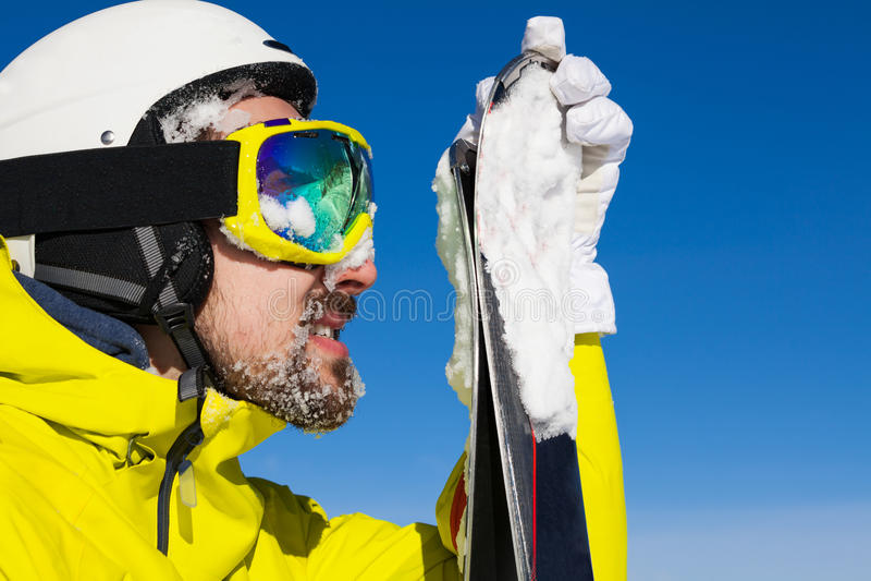Close portrait of man holding ski stock photos