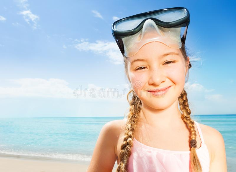 Close portrait of nice braided girl in scuba mask stock photos