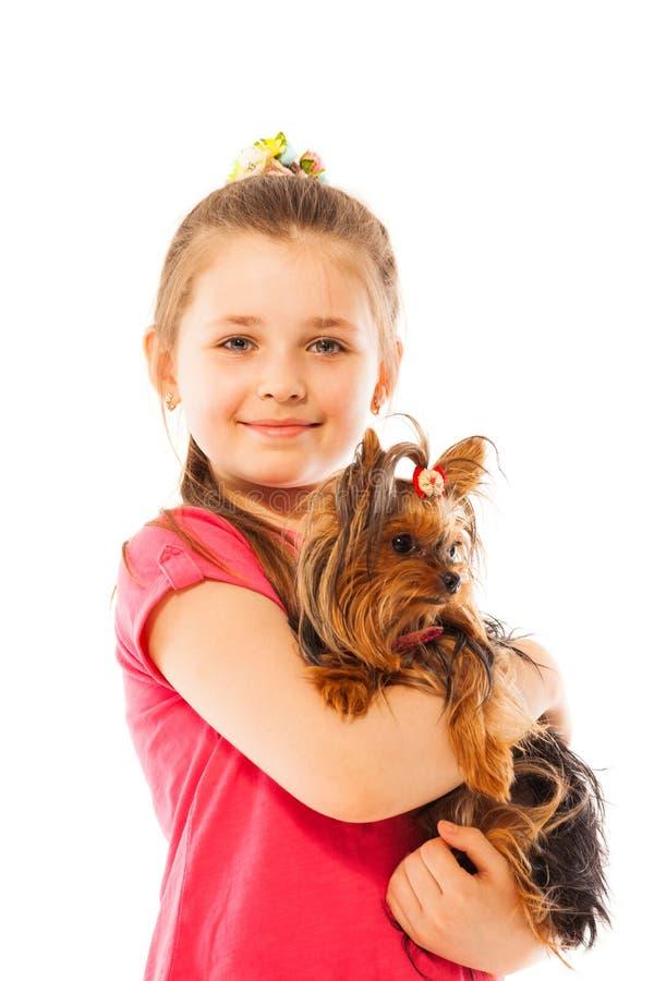 Close portrait of nice girl hug little pet dog stock photography