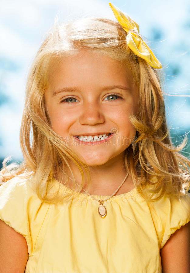 Close portrait of smiling blond little girl royalty free stock photos
