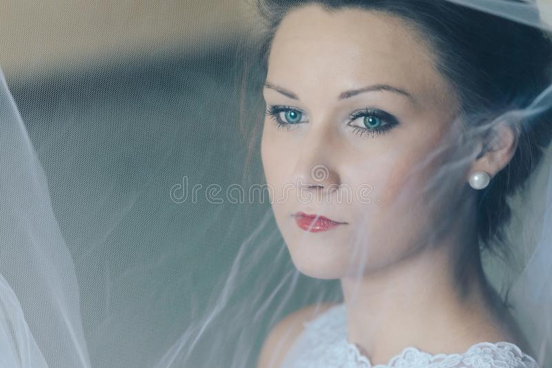 Close portrait of young beautiful bride royalty free stock photos