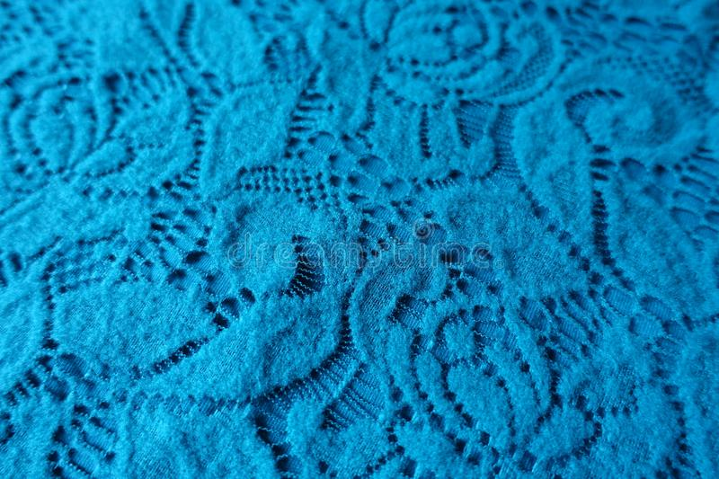 Close shot of blue-green lacy fabric. Close shot of blue green lacy fabric stock photo