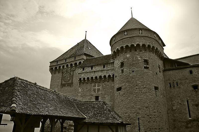 Close shot of the Chillon castle with a cloudy sky in the background. A close shot of the Chillon castle with a cloudy sky in the background stock photos