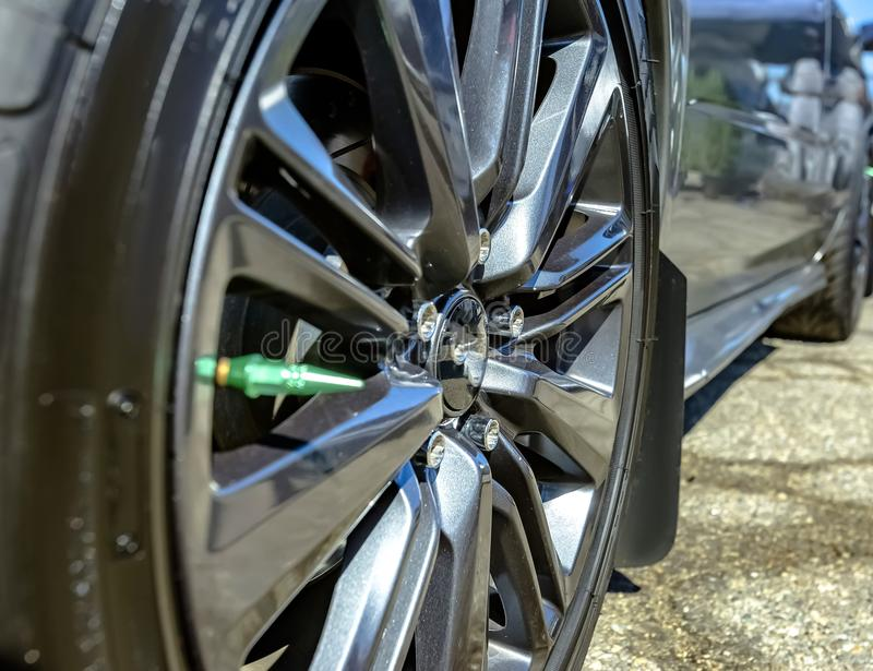 Close shot of chrome rims on a black car stock image