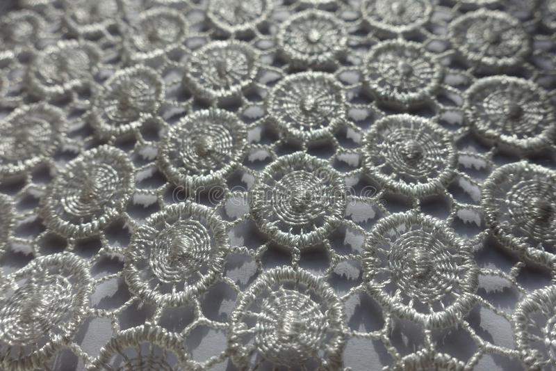 Close shot of white lacy fabric stock photo