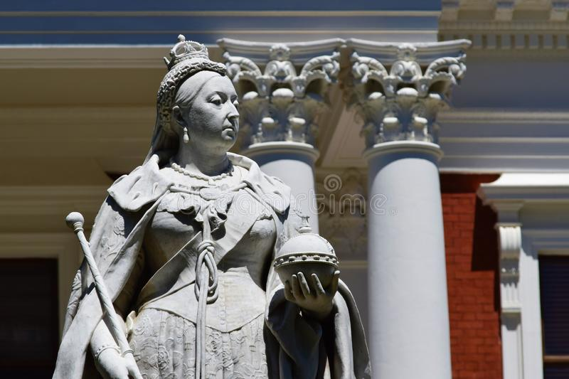 Close shot of Queen Victoria`s statue with a blurred background at daytime royalty free stock photos