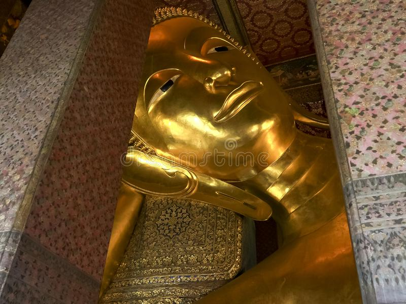 Close shot of the reclining buddha at wat pho temple in bangkok royalty free stock image
