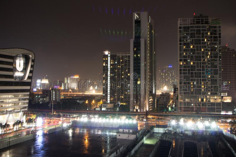 Skyscrapers with lights on the offices by night, Bangkok , Thailand stock image