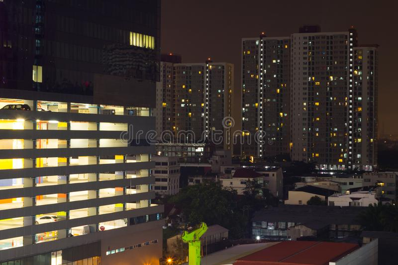 skyscrapers with lights on the offices by night, Bangkok , Thailand stock images