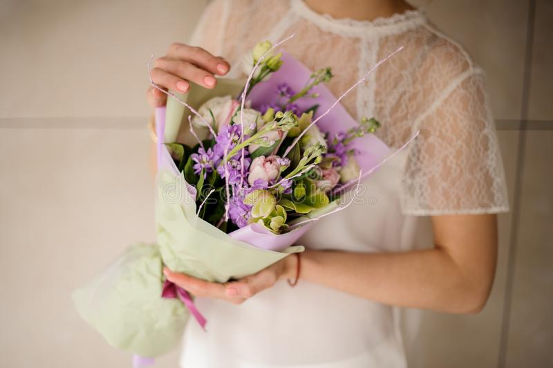 Close shot of wedding bouquet in woman hands stock images