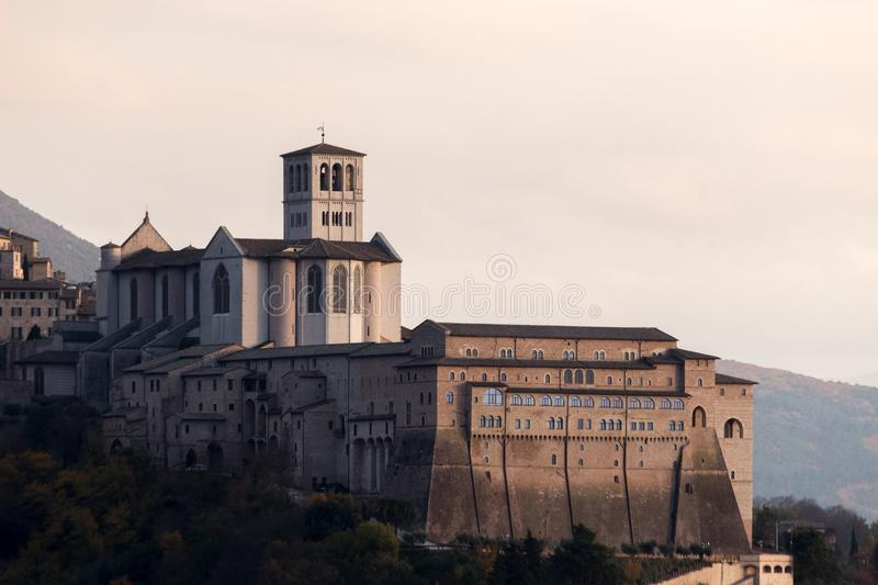 Close, side view of papal St. Francis church in Assisi, Umbria, royalty free stock image