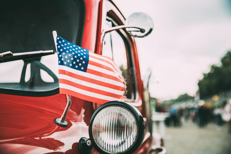 Close Side View Of Red Pickup Truck With Small American Flag Waving stock photography