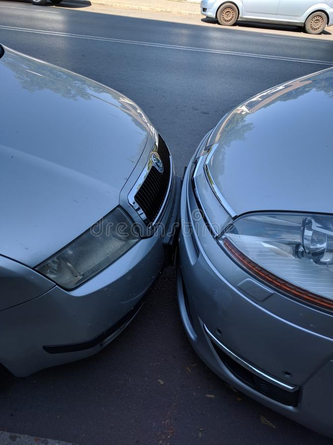 Close to each other. Two cars with number plates touched - parked very close stock photos
