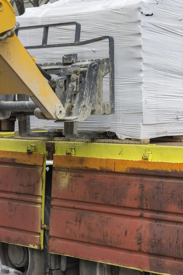 Close of unloading works stock photos