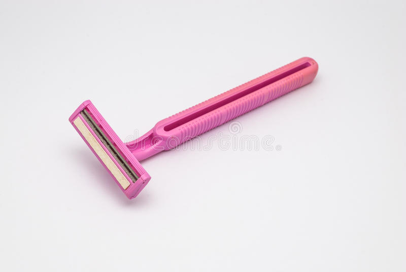 Close up à lâmina gêmea cor-de-rosa usada suja velha das lâminas, isolada imagens de stock royalty free
