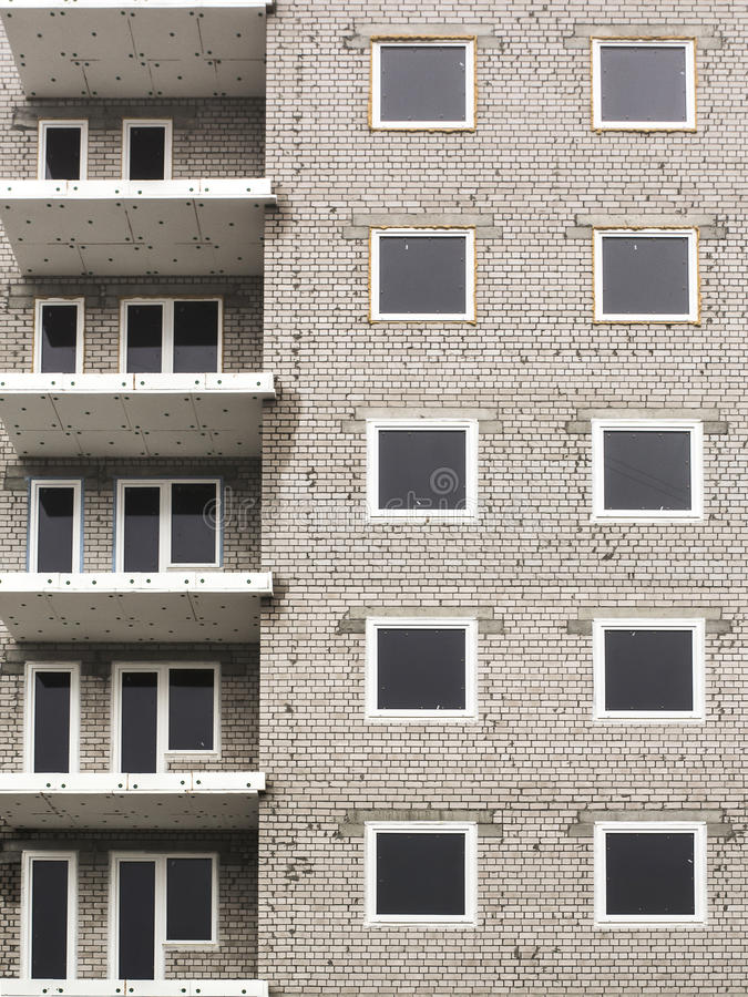 Close up of abandoned apartments building under construction abstract royalty free stock photo
