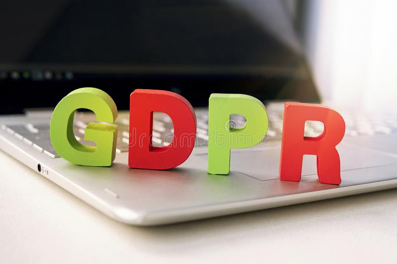 Close up of abbreviation GDPR set on the bottom of laptop standing on white table. Concept of personal data control and protection stock photos